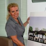 Broker, Tami Beckel, in the conference room reviewing elevation renderings in Boca Raton, FL.
