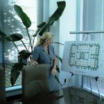 Broker, Tami Beckel, in the conference room in Boca Raton, FL reviewing a site plan.